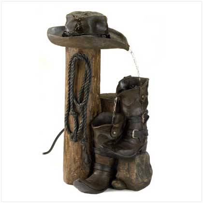 if youre crazy for cowboy decor then this is the phone for you western sculpture of saddle boots and cactus cleverly conceals a full function push - Cowboy Decor