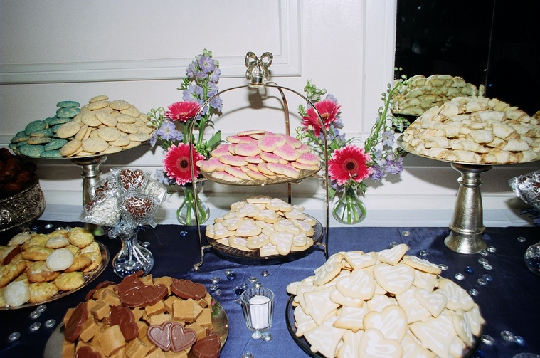 a cookie table is a tasty addition to any wedding reception with our variety of beautiful trays and decorations we can make your cookie table a real