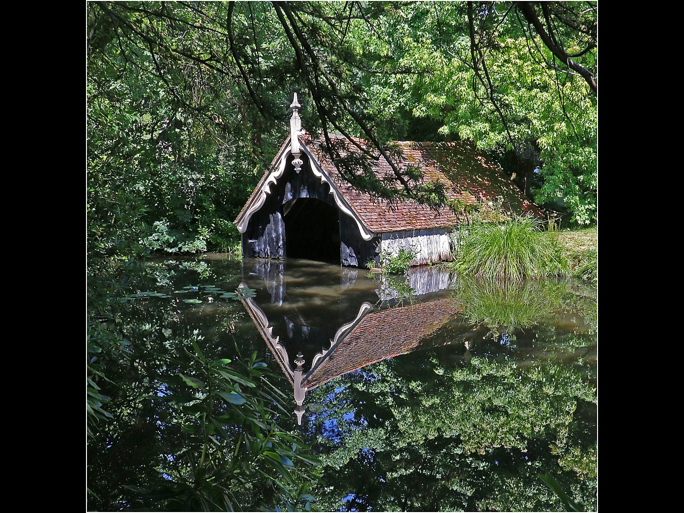 Boat House with Reflections