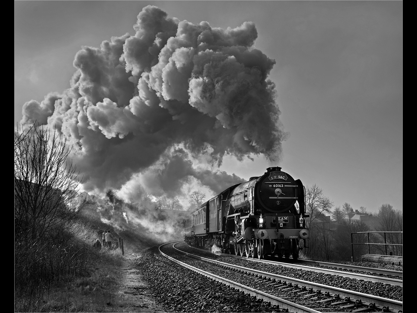 A ray of light catches Tornado passing past Langcliffe.