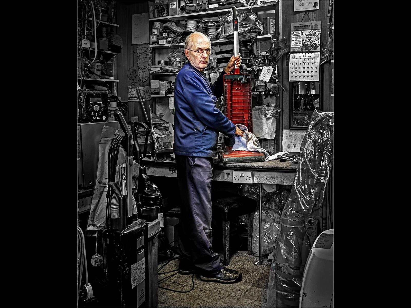 The vacum repair man in his workshop