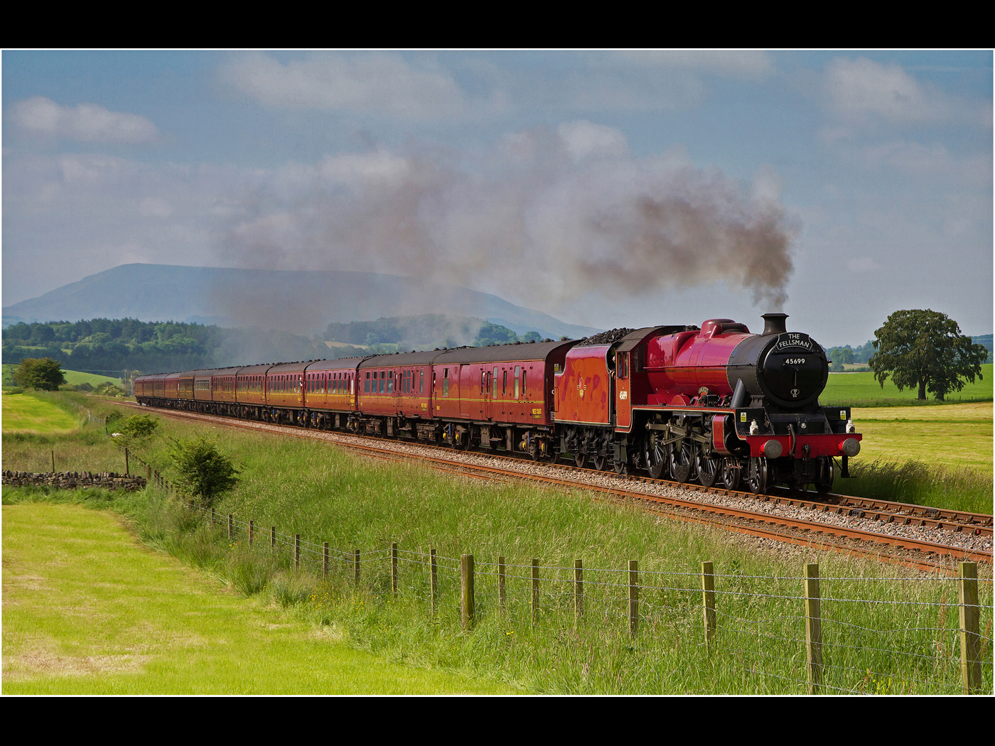 The Fellsman passing Pendle Hill