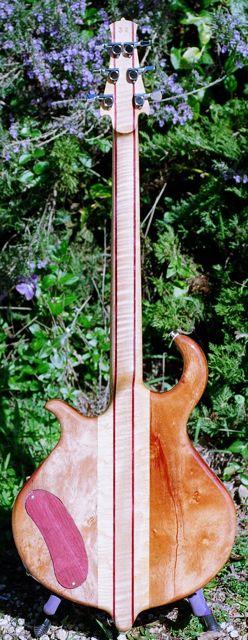 5 piece figured maple neck through body semihollow electric guitar