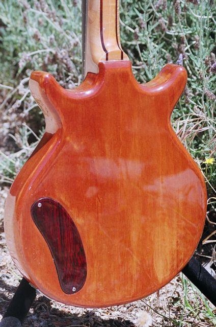 semihollow mahogany body, five piece set neck
