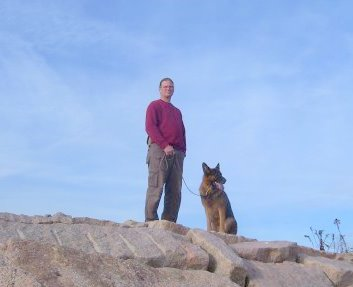 Professional dog trainer Scott Kalisz with my male German Shepherd Dog Fanto on the pier at Meigs point