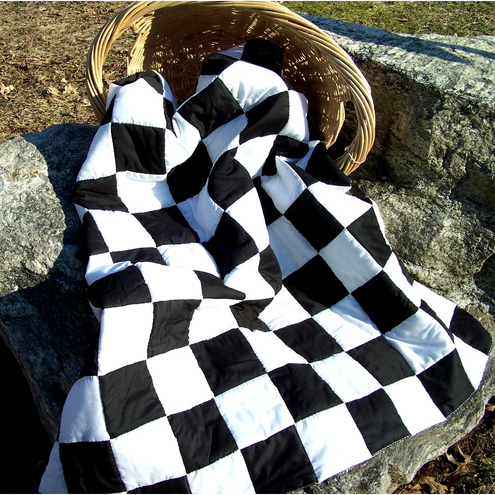 black and white checker pattern lap quilt