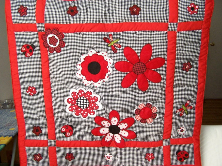 Red and Black flowers with Lady bugs and dragonflies quilt