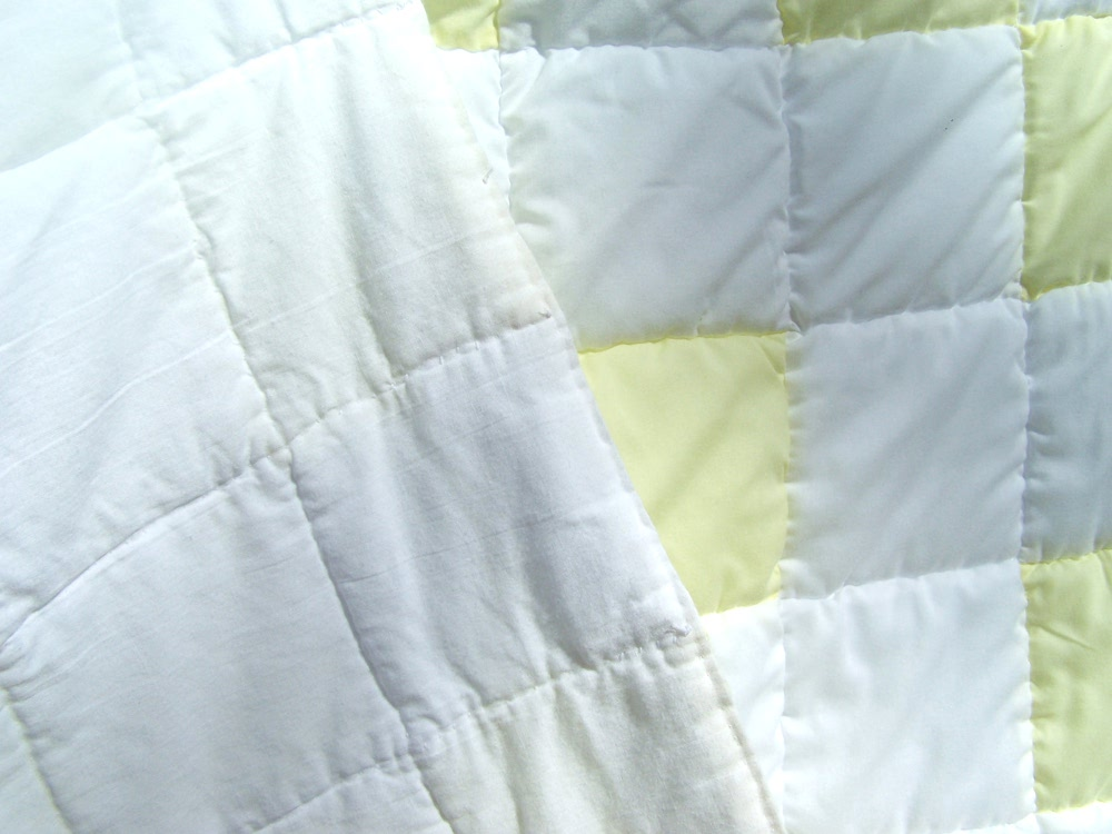 yellow and white patchwork quilt