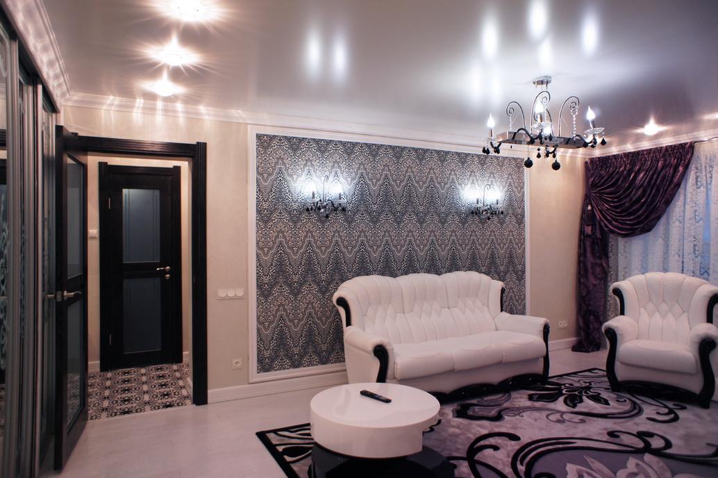 Дизайн гостиной комнаты в двухкомнатной квартире. Красивый орнамент. Черно-белый интерьер