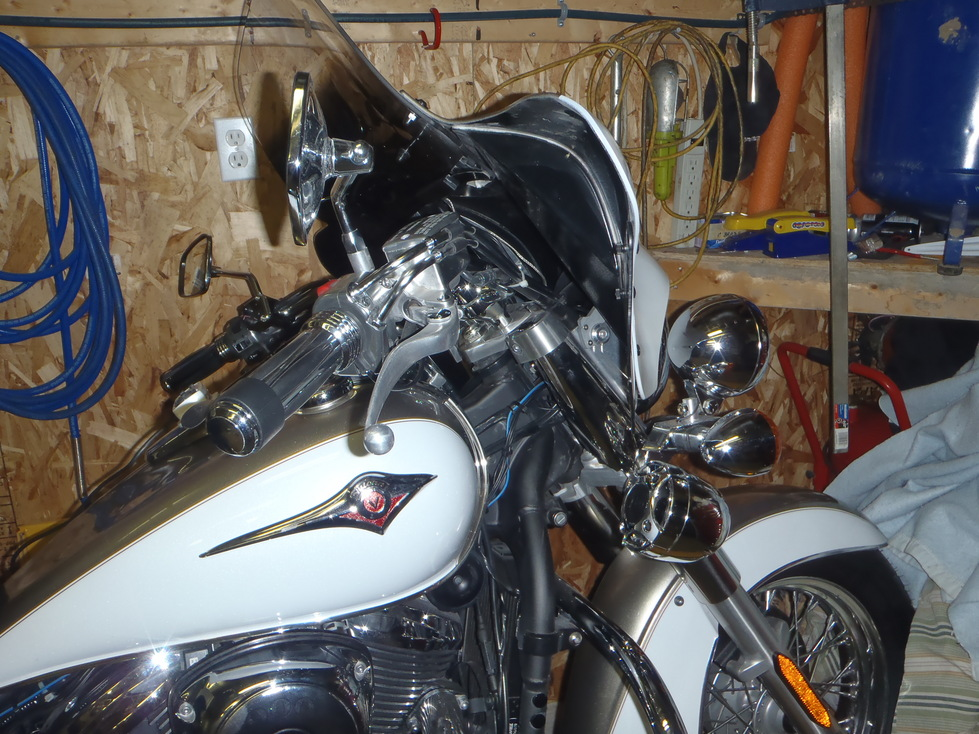 Chrome Bullet Speakers mounted on front of Mototrcycle