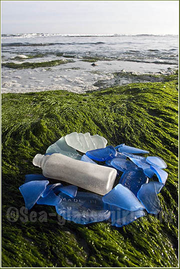 photo of Eastern Shore with collection of sea glass, mostly blues and greens