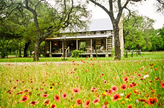 AB Butler's bed and breakfast log cabin in Fredericksburg, Texas.