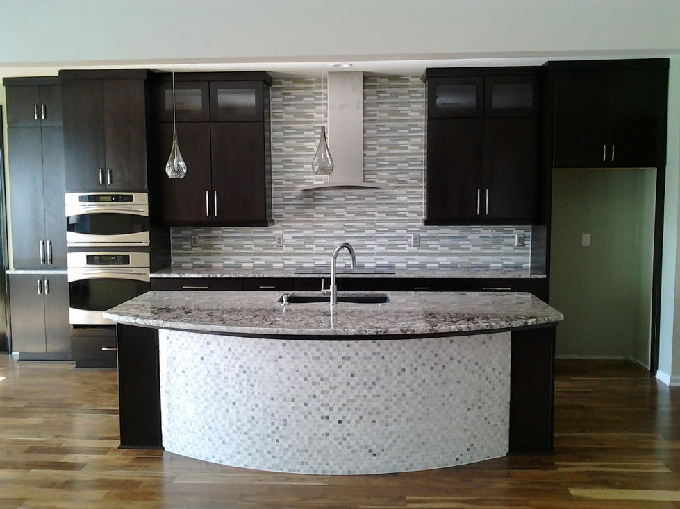 Front Shot of a custom kitchen counter with mosaic tiled backsplash