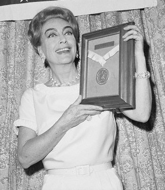 Joan being presented with the USO Woman Of The Year Award
