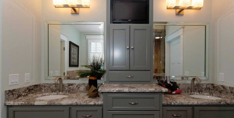Contemporary master bathroom with built-in TV from Parade of Homes-winning house by Edgerton Contracting, Inc.