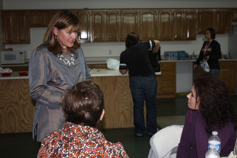 Jeanne Davis (TBC Executive Director's wife) talking with ladies.