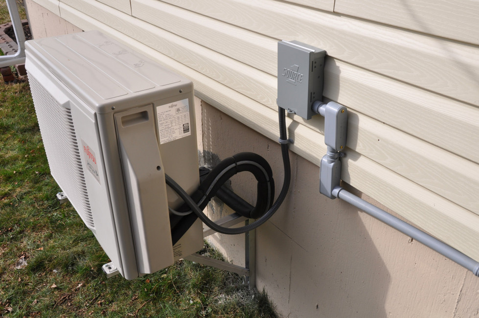Ductless Split Heat Pump on wall brackets - Quispamsis
