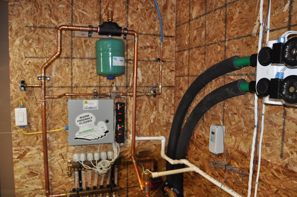 Triple function geothermal heat pump showing the radiant floor zoning-Millidgeville