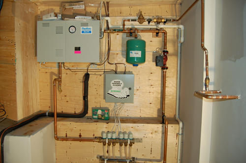 Radiant floor heating showing boiler and accessories including zoning manifolds-Sussex