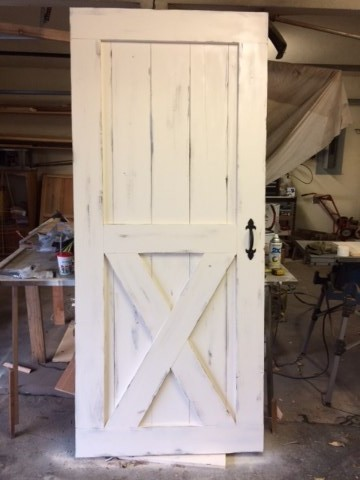 This distressed barn door was installed in the Goddard School of Edmond Ok. Go see it. See Testimonial page.  & Exterior Shutters in the Oklahoma City Area